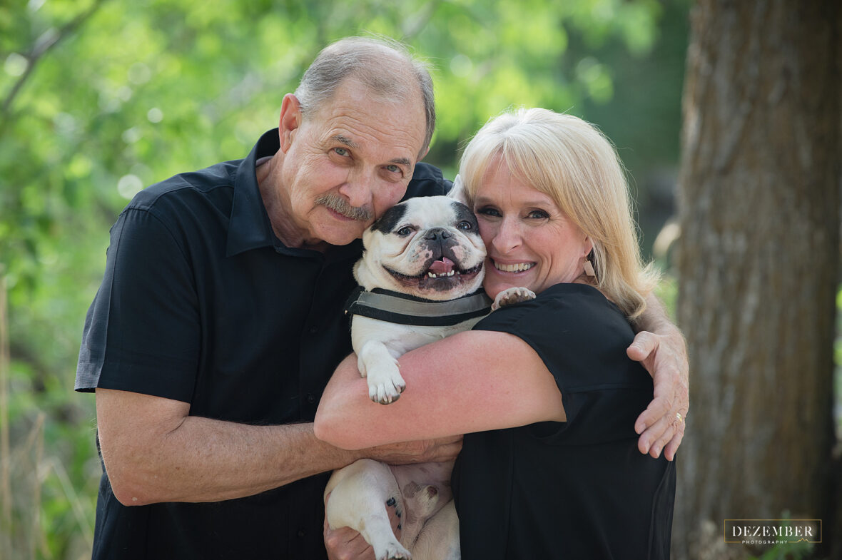 Pups are a part of the fam! Parents pose with their dog for a photo