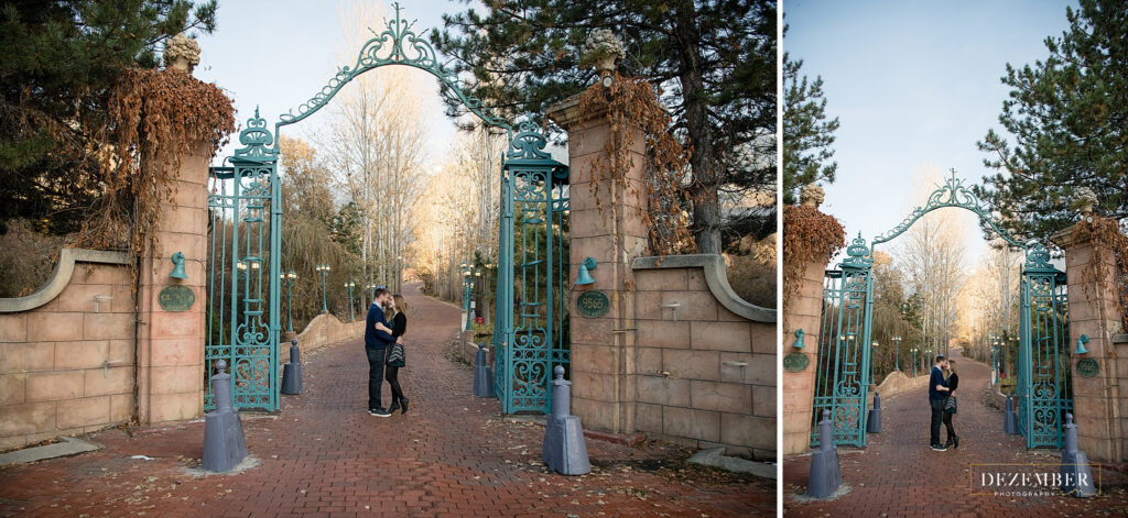 Newly engaged couple stand under teal La Caille gates