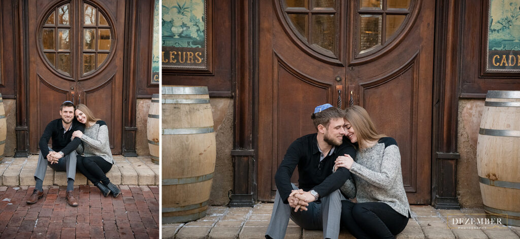 Couple sits in front of big La Caille Doors