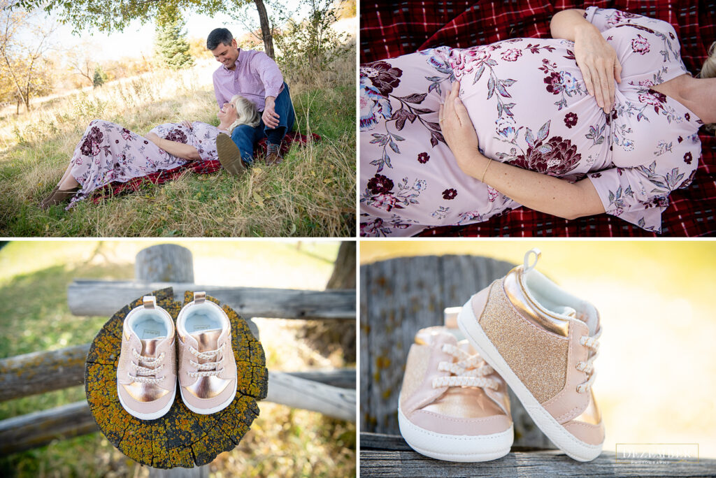 Couple lays in the park with a pair of baby shoes