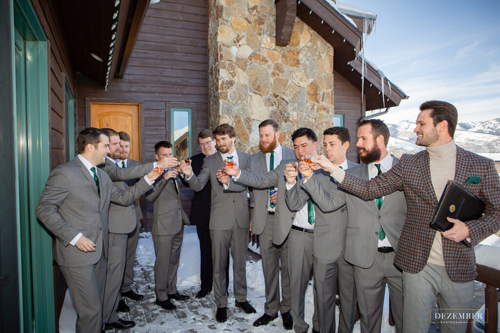 Montage Winter Wedding the groomsmen have a shot on the deck