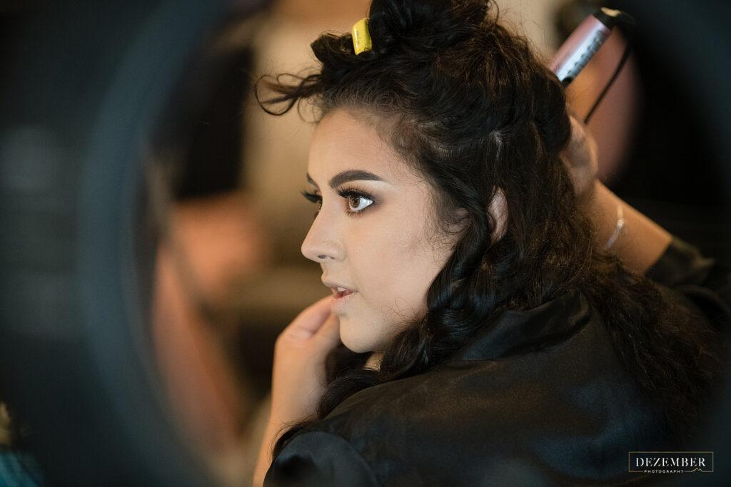 Bride curls her hair