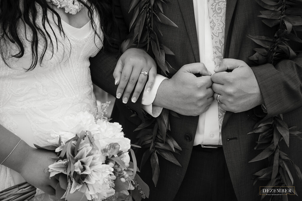 Black and white bride and groom detail shot of hands