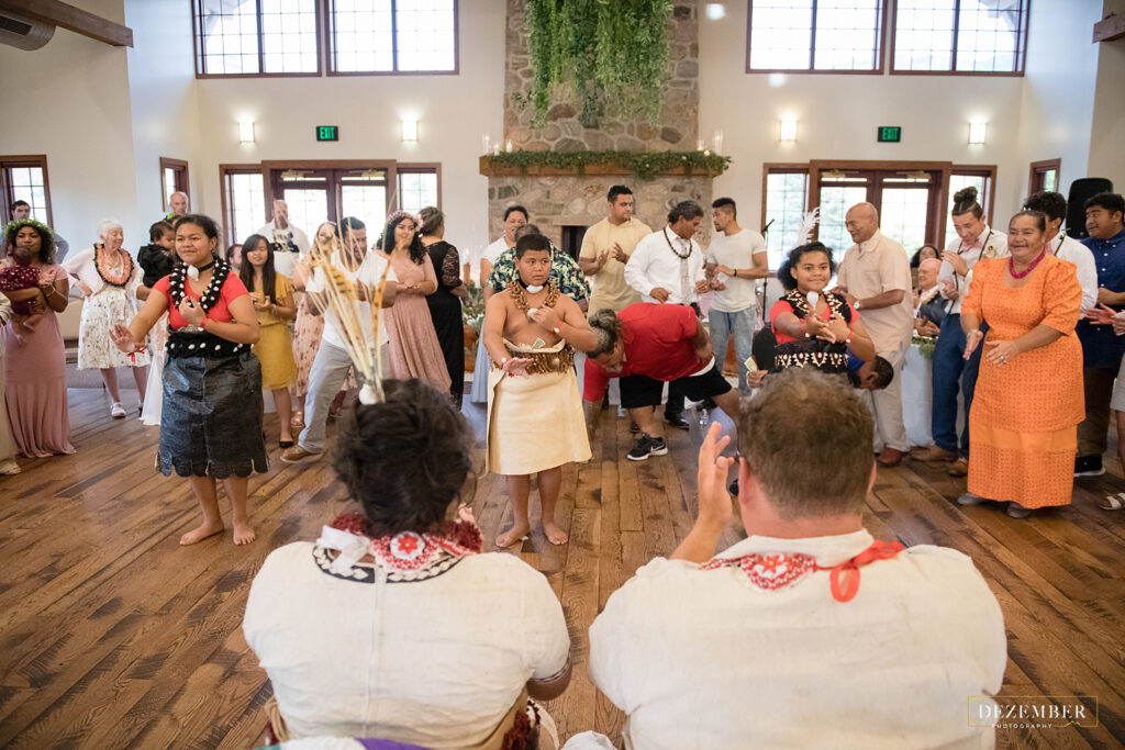 Newlyweds watch the Polynesian money dance