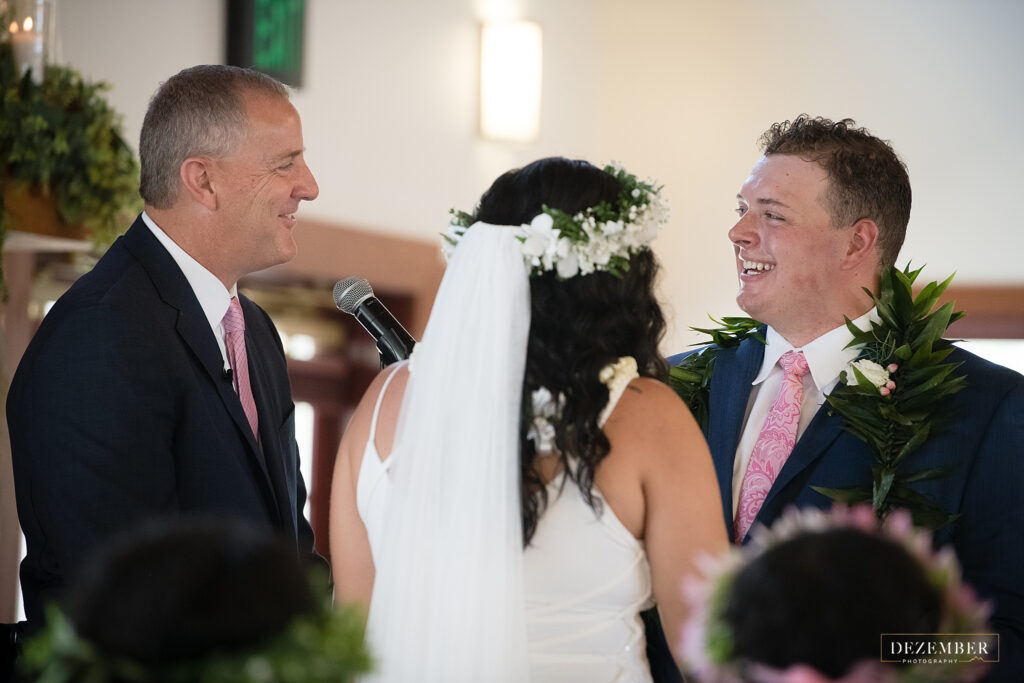 Groom laughs as officiant speaks