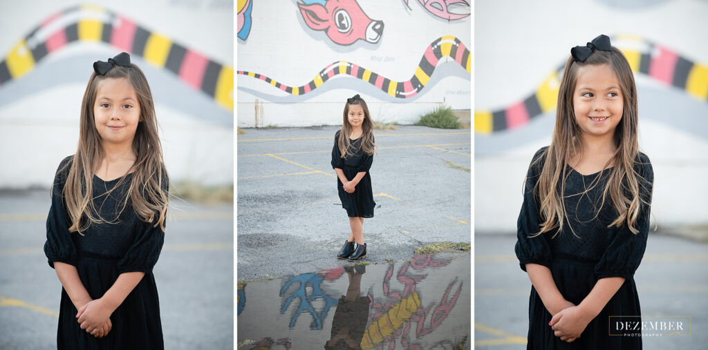 Girl in black dress portraits in front of mural