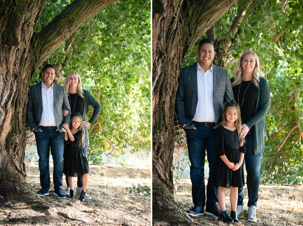 Family poses under big tree