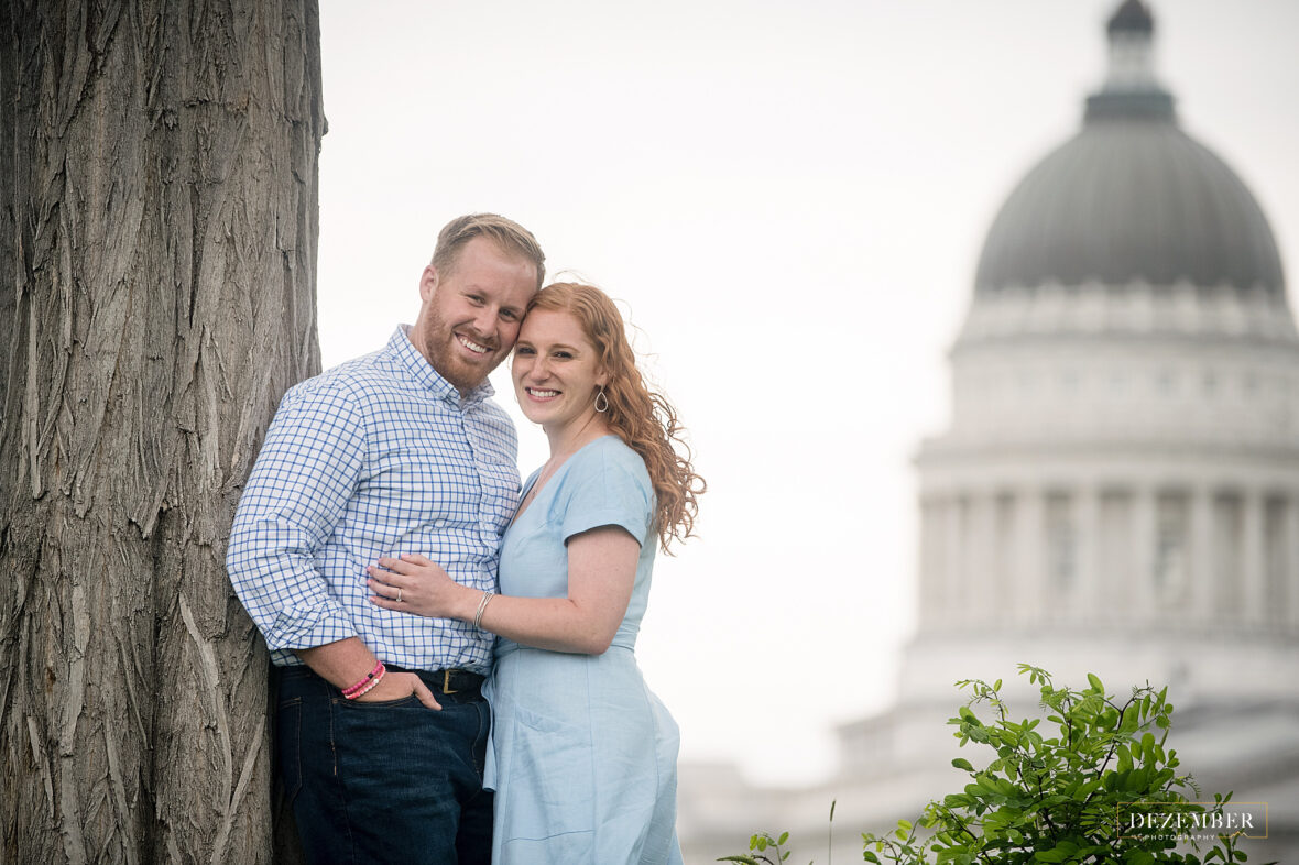 Utah Capitol Engagements couple poses with capitol building in the background