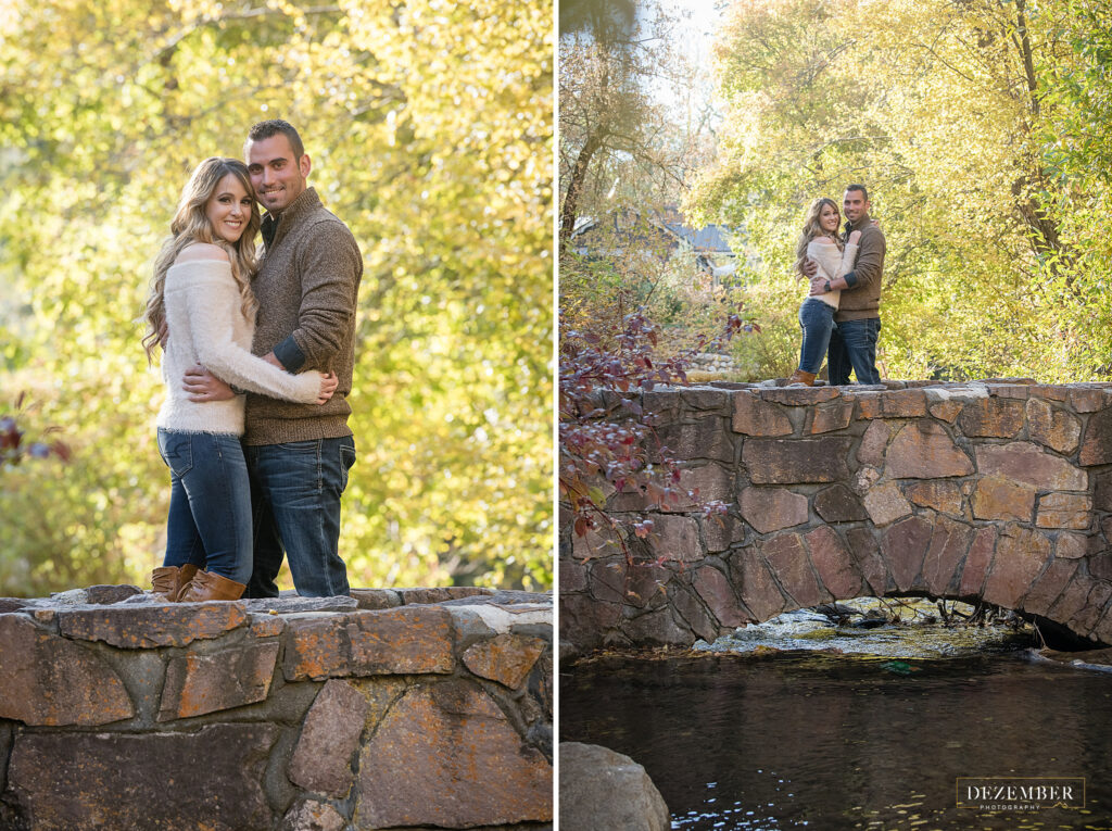 Couple poses on bridge over river