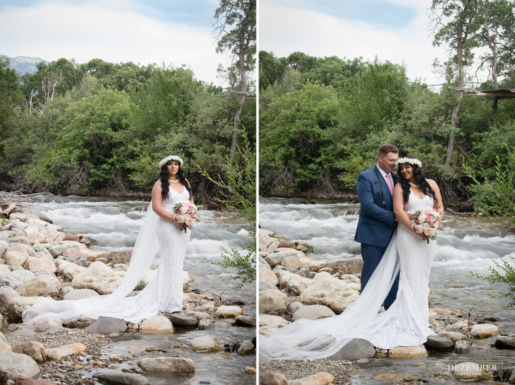 Bride and groom pose near river