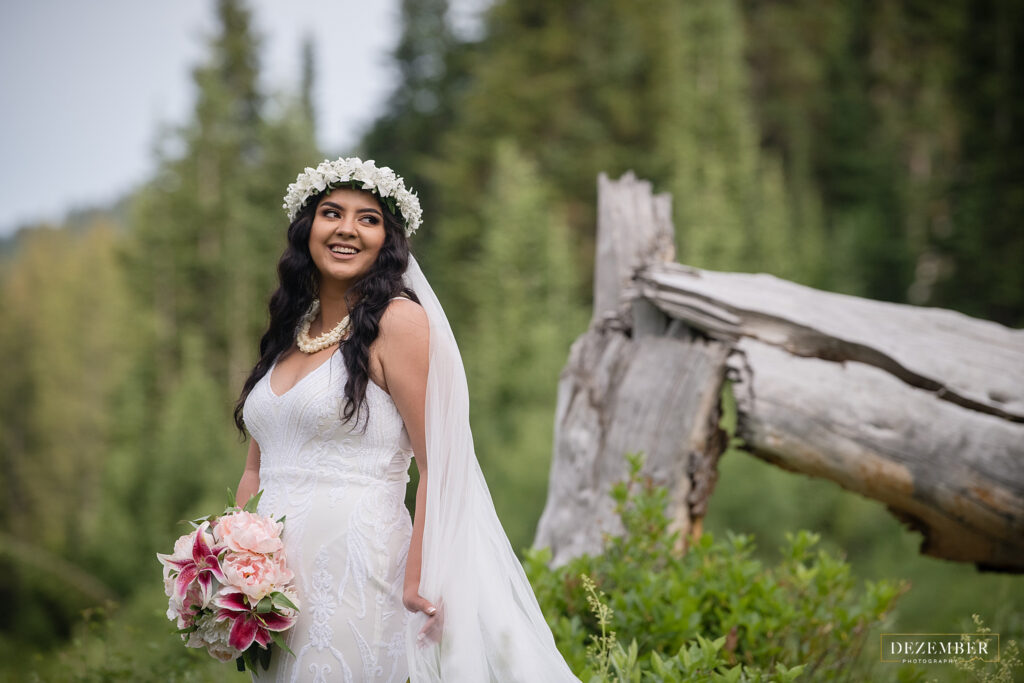 Bride smiles and looks at groom off screen
