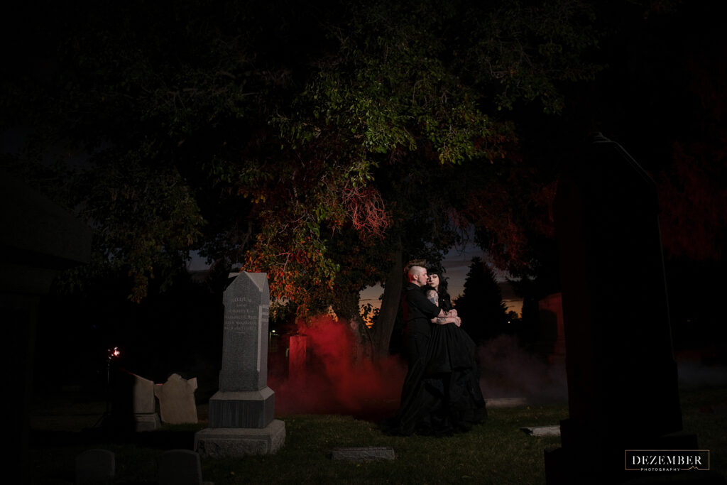 Goth bride and groom in cemetery