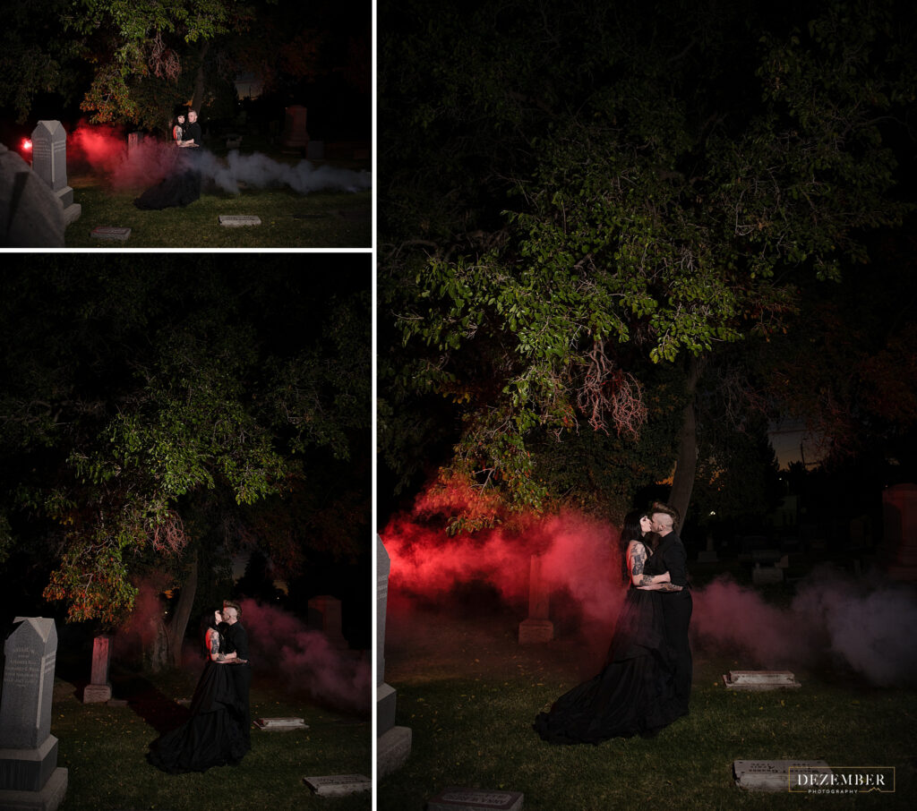 Goth couple kiss in cemetery with smoke bomb