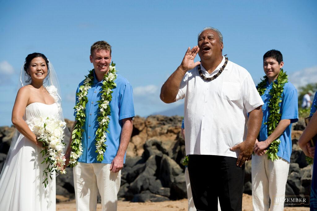 Hawaiian officiant calls out