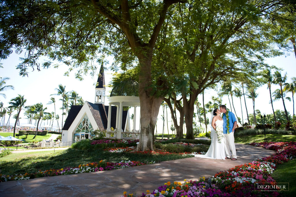 Bride and groom in front of Maui church