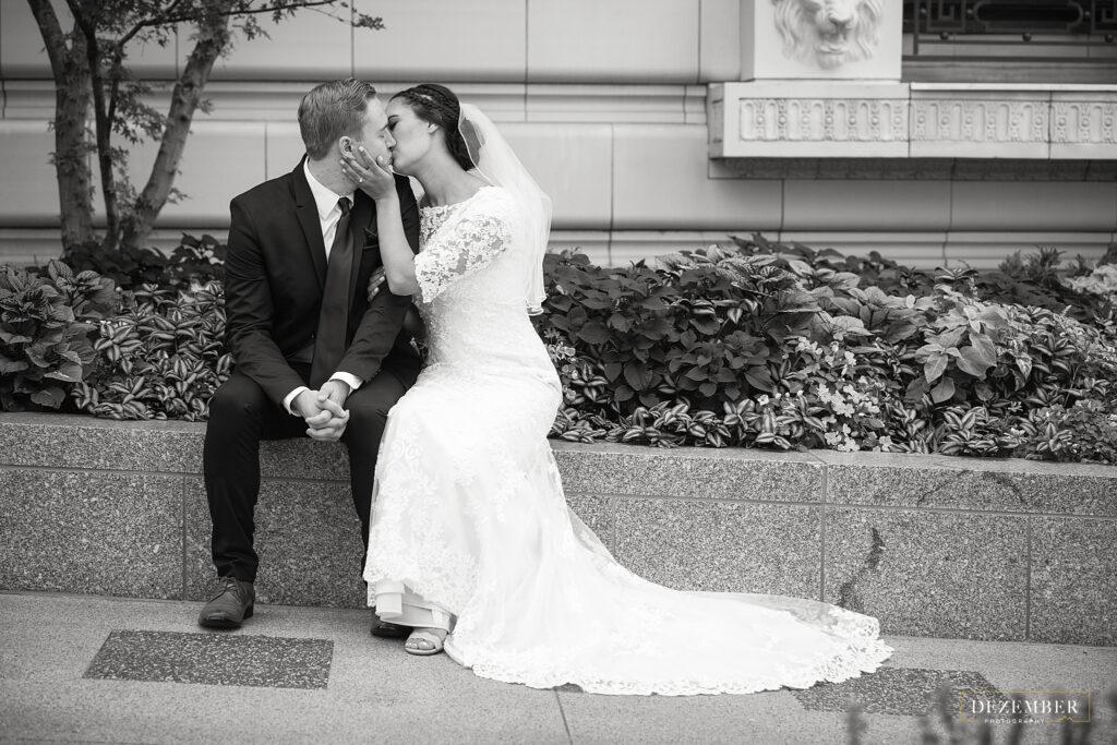 Newlyweds kiss black and white